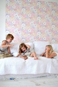 FRIVOLE family. Son, daughter, sister. White interior, vintage wallpaper, linen curtains. Copper light, wired lampshade