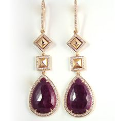 18K Yellow Gold, Ruby, and Diamond Earrings  Over 31 carats of rich-colored faceted rubies dangle from these exquisite earrings, set in highly polished 18K yellow gold. Dripping in diamonds (238 to be exact), any woman who wears this earring will feel the utmost sense of luxury.