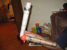 Make a model arm with paper tubes, rubberbands and a ball.