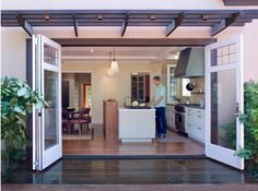 Modern Kitchen Photos Open Concept Kitchen Design, Pictures, Remodel, Decor and Ideas - page want those doors! Indoor Outdoor Kitchen, Patio Kitchen, Outdoor Kitchen Design, Outdoor Rooms, Outdoor Kitchens, Door Design, House Design, Accordion Doors, Open Concept Kitchen