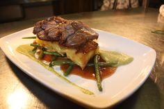 Herb crusted rump of lamb, potatoes daulphinoise, buttered green beans, minted broadbean puree, port jus
