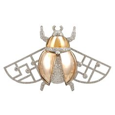 CARTIER Diamond and Honey Quartz 'Scarab' Brooch | From a unique collection of vintage brooches at https://www.1stdibs.com/jewelry/brooches/brooches/