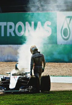 """f1championship: """"Lewis Hamilton l Malaysia 2016 """" A dejected Lewis Hamilton looks at his smoking engine that gave out on lap 43."""