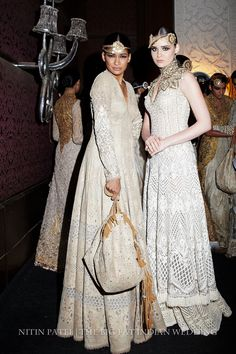 White long dresses with cut stitching| Indian haute couture fashion | Designers Rimple & Harpreet Narula at India Couture Week