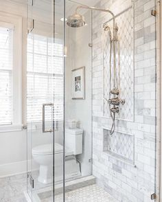 Marble Tile Shower Stall with Silver Fixtures