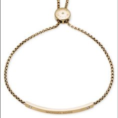 ✨MICHAEL KORS bracelet % AUTHENTIC MICHAEL KORS bracelet- Keep it casually cool with this box-link chain, logo bar slide bracelet.  Crafted of yellow gold-tone mixed metal.  Adjustable length.  Michael Kors box and jewelry pouch is included. Paired with a watch or on its own - simply stunning! Michael Kors Jewelry Bracelets