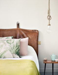 Hotel Henriette in Paris, a vintage leather gym mat as a headboard (I might go for a beautiful old rag rug instead)