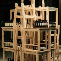 Using chairs as shelving/merchandising. Aesop. Installation by Hiroko Shiratori