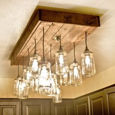 A novel way to recycle a reclaimed wood pallet is to make this mason jar chandelier for above a dining table.
