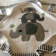 This blanket was made by one of Pattern World's customers - Natalie Siedbald Firmani using our pattern. She allowed me to share her work on LoveCrochet website :) Natalie's comment:Crochet Baby Blanket - Three Elephants crochet project by Lina Pattern Wor Crochet Elephant Pattern, Crochet Blanket Patterns, Baby Blanket Crochet, Baby Patterns, Knitting Patterns, Crochet Baby Booties, Knit Crochet, Elephant Baby Blanket, Baby Blankets