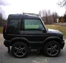 Short wheel-base land rover discovery - where is the wind-up key? Love photo shop.