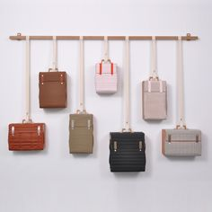 - Dutch designer Lotty Lindeman's Tassenkast is a collection of luggage that combines to become a suitcase cabinet. The system is a beautiful,. Pop Design, Visual Merchandising, Suitcase Shelves, Bag Display, Display Wall, Store Displays, Retail Displays, Retail Design, Store Design