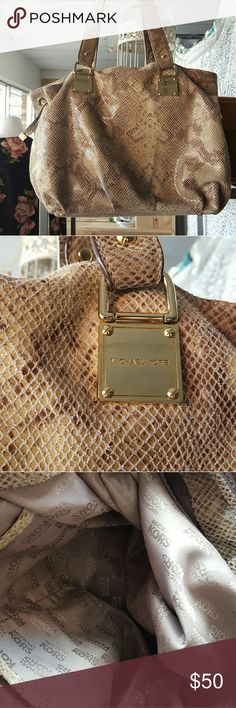 Authentic Michael Kors Handbag This bag is an authentic Michael Kors Snakeskin bag.  It has some blue fading it from wear but is not very noticeable when it is on.  Interior is in amazing condition.  This is a soft, beautiful bag! Michael Kors Bags