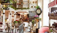 Living room and adjoining dining room with Christmas decorations, including wreaths, fireplace mantel decor, large Christmas tree and a holiday centerpiece. Christmas Fireplace, Christmas Mantels, Fireplace Mantels, Christmas Decorations, Holiday Decorating, Decorating Ideas, Bar Madrid, Best Hotels In Madrid, Lowes Creative
