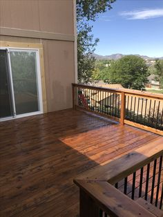 Cedar deck stained in Superdeck Canyon Brown. Cedar railing with black aluminum balusters. Deck With Pergola, Pergola Shade, Patio Roof, Pergola Plans, Diy Pergola, Pergola Kits, Pergola Ideas, Black Pergola, Railing Ideas
