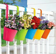 Add color to your outdoor decorating with a fence covered with suspended flowerpots. It's wall art for your outdoor room. Start with nine terra-cotta pots and coat the bases with spray paint. Next, plot the grid arrangement and secure pot hangers to the fence. Finish by suspending pots from hangers and filling each container with brightly colored annuals or herbs.