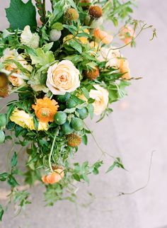Spring shades of orange blooms + greens