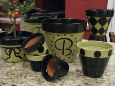 Painted Pots This pic is during the process (before adding the white which I think really helped the colors to POP! I primed the (clean & dry) terra cotta with 2 coats then painted with latex and a coat of polyurethane. Painted Clay Pots, Painted Flower Pots, Cute Crafts, Diy And Crafts, Pot Plante, Clay Pot Crafts, Garden Crafts, Container Gardening, Craft Projects
