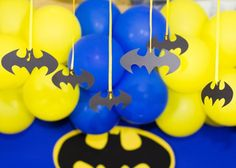 Batman Superhero Birthday Party Planning Ideas Decorations.... Yellow, black & blue ballons hanging and have bats hanging down.. Heres a thought.. Instead of wearing traditional hats, wear batman masks! xD (for kids & adults!)