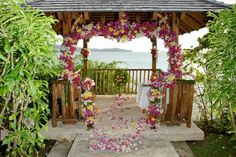 """Wedding Gazebo with Bougainvillea petals at Calabash Cove, St. Lucia. --- outline the entrance to the gazebo with flowers, balloons, lights or tulle. Could then add spiral """"wheels"""" and make the whole gazebo Cinderella's carriage..."""