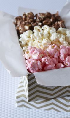 White chocolate, milk chocolate, and strawberry coated popcorn make up a delicious and beautiful dessert trio perfect for gifting and entertaining!