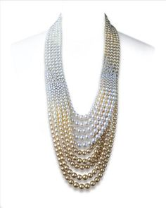 Mikimoto necklace of white, cream, grey, yellow, gold, and bronze pearls with an 18k clasp