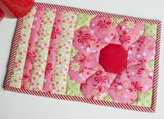 "The Column Sidebar from the Patchsmith's One Block Mug Rugs pattern book turns any 6"" block into a functional and very pretty mug rug."