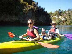 Family fun kayaking on the Waikato River near Taupo, New Zealand