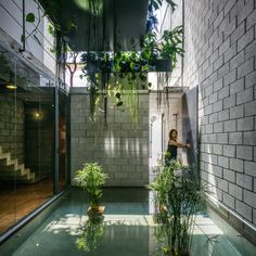 Brazilian studio Terra e Tuma has designed a slender urban home with concrete block walls and rooms organised around two interior courtyards.