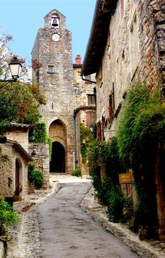 Belfry and gateway in the quaint village of Bruniquel in France in the Pyrenees