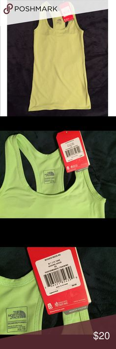 NWT The North Face Performance Tank The North Face Green Performance/ Training Tank. Tight fitted for your high intensity workouts keeps you focused. NWT! The North Face Tops Tank Tops