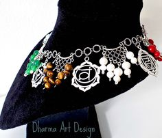 Personalized posteriori customization, one-of-a-kind handcrafted statement choker necklace with carefully selected Chakra Stones, wire wrapped to Bali style connector beads. Extended customization of the original necklace for the customer's request: charm pendants depicting the chakra symbols, remake of the stone charms with spiral headpins, adding an extra set (35pcs) of larger chakra stones (wire wrapped), rhodium plated Bali style T-clasp.