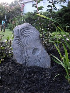 Earthly Delights, Backyard Garden, Brick Paths, Sculptures, Raised Beds, Stone carving adds interest. Carving in rock is challenge.  , Gardens Design