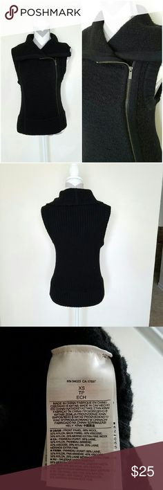 Banana Republic Chunky Zipper Sweater Vest! Black wool sweater vest with bronze colored off-centered zipper down the front. Chunky collar. Soft and warm. Length is about 23 inches and armpit to armpit is about 17 inches. Great condition! Banana Republic Sweaters