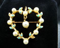 Here is a 1960s vintage Victorian Revival 14K gold dangle pearl open heart brooch pin pendant with 9 white cultured pearls and tiny turquoise beads. Two turquoise beads are missing. Hallmarks: 14K gold (on the bail) Size: 1 1/4 north to south including chain bail, 1 east to west. Pin with a Clip On Earrings, Heart Earrings, Drop Earrings, Cream And Gold, Turquoise Beads, Cultured Pearls, Purple Amethyst, Photo Jewelry, Brooch Pin