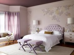 The lavender hues in this bedroom give the space a calm, serene feel. The wall design adds some style to the subtle room.