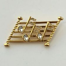 Gold tone music staff with notes white rhinestones pin brooch, signed... Lot 16C