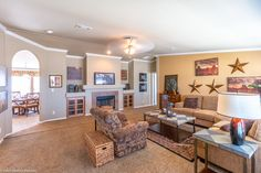 """The Bonanza Flex manufactured home has a great cozy living area and fabulous arched doorway into the dining area and kitchen.  This is perfect for those who aren't in love with the whole """"open"""" concept! 3 Bedrooms, 2 Baths, 2,302 Sq. Ft.  - Available in Texas, Oklahoma and Louisiana only."""