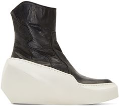 Textured leather ankle boots in black. Panelled construction throughout in alternating textures. Round toe. Diagonal zipper closure at inner side. Rounded collar. Thick raised sculpted rubber platform in off-white.Tonal stitching. Approx. 3.5
