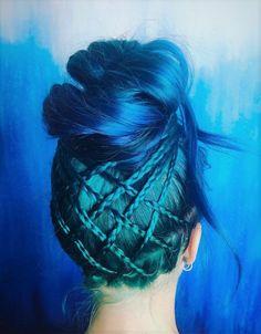 Blue and turquoise dyed hair with high bun by vertigohairnyc