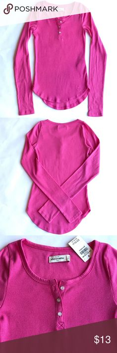NWT Abercrombie Kids rubbed henley Super soft pink long sleeve henley. Pretty buttons. Slim fit but lots of stretch. Long silhouette. Great layering piece. Never worn. Perfect condition. abercrombie kids Shirts & Tops Tees - Long Sleeve