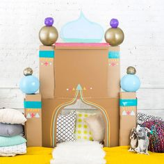 Aladdin fort made from cardboard boxes and beach balls Cool Forts, Indoor Forts, Aladdin Party, Jasmine Party, A Frame Tent, Cardboard Toys, Cardboard Playhouse, Cardboard Furniture, Playhouse Plans