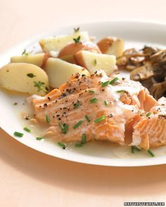 A light white wine and chive sauce makes roasted salmon especially moist. Serve with sauteed mushrooms and steamed potatoes.    Get the Roasted Salmon with White-Wine Sauce Recipe    Next: Salmon and Zucchini Baked in Parchment