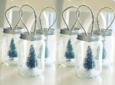 Don't know what to do with all those baby food jars in your pantry? You do now– make adorable mini Christmas tree ornaments with them!  Turning Baby Food Jars into Christmas Ornaments | Craft Tutorial | via putitinajar.com