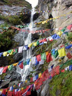Prayer flags and waterfalls in Bhutan