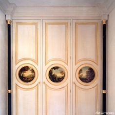 Three pastoral views, set within the gilded mouldings, black ebonised columns abd broken colour paint finish,  private residence, London