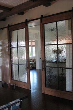 Glass barn door lounge/playroom.
