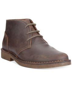 Dockers Tussock boots strolled on the chukka scene with sleek leather lines and fabric laces. | Leather upper; rubber sole | Imported | Dockers men's chukka boots | Plain toe | Lace-up closure with bl