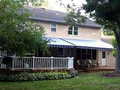 Blue Sunbrella Fabric with KE Outdoor Design retractable Bella Awning installation by Milanese Remodeling. Cool Deck, Diy Deck, Fabric Awning, Retractable Awning, Shade Structure, Exterior Remodel, Pink Houses, Building A Deck, Outdoor Living