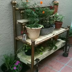 Repurposed antique brass bed into a potters bench